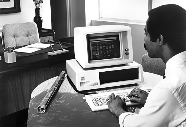 A man working on an IBM PC 5150.